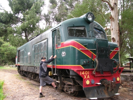 Mike inspecting an old Hotham Valley loco, Hotham Valley Railway, Dwellingup, Western Australia.
