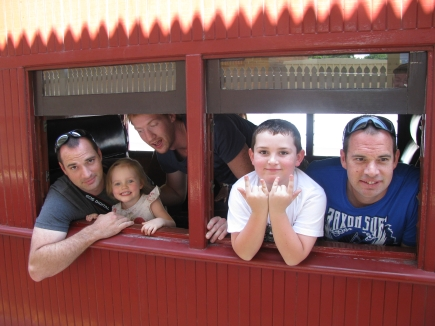 The Hartle clan hanging out of one of the vintage carriages ready for their ride.