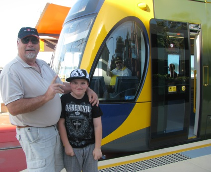 Mike and grandson saying goodbye to driver on Gold Coast G.